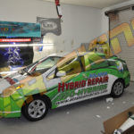 Atlanta Hybrids corporate wrap with windows and lettering