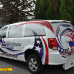 Affordabel Freedom Mobility SUV wrap with windows, lettering, and custom graphics.