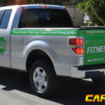 Balance Fitness corporate wrap with tailgate, side logos, lettering, and hood logo.
