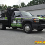Bo Stanley work vehicle wrap with door graphics, racing stripes, lettering, and hood logo.