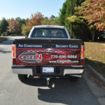 CagedN corporate wrap with custom graphics, lettering, and logos