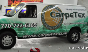 CarpeTex coporate van wrap with letter, custom graphics, and Side/hood logos.