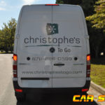 Christophe's togo corporate van wrap with side logos and lettering