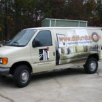 DHI Furniture corporate vehicle wrap with lettering, custom graphics, and side logos.