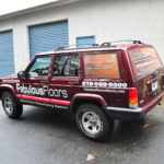 Fabulous Floors corporate jeep wrap with windows and lettering