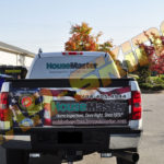 House Master corporate wrap with custom graphics, windows, logos, and lettering.