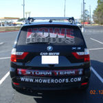 Howe Roofs simplistic corporate wrap with lettering and logo.