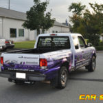 Innovative Fitness half wrap with windows and lettering.