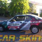La Cabana corporate car wrap with logos and lettering