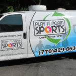 Play it again sport corporate van wrap with windows and lettering