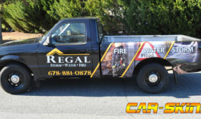 Regal corporate full wrap with hood and side logos, custom graphics, and lettering.