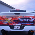 Xtreme Auto Lighting half wrap with lettering and logos.