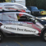 Kent D Row corporate SUV wrap with custom graphics, side/hood logo, windows, and lettering