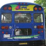 Kiddos custom corporate bus wrap