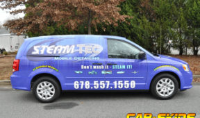 Steam TEc corporate van wrap with lettering, windows, and logos.