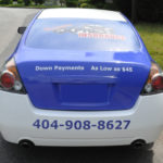 tramites xpress insurance corporate with windows, logos, and lettering.