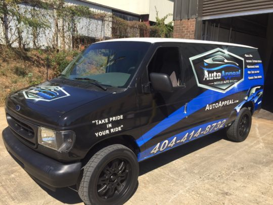 Auto Appeal corporate half wrap with logos and lettering