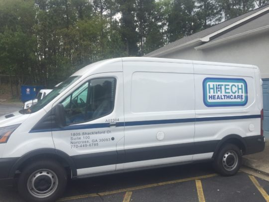 HiTech Healthcare simplist corporate van wrap with lettering and side logo.
