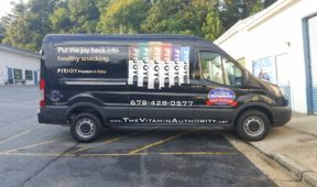 Vitamin Authority simplist corporate wrap with lettering, graphics, and side logos.