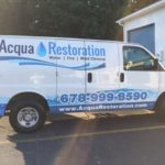 Aqua Restoration corporate wrap with windows, logos, and lettering.