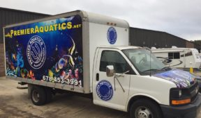 Premier Aquatics trailer truck wrap with side/hood logos and lettering