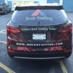Rock Staffing corporate half wrap with side lgos, lettering, windows, and custom graphics