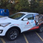 Rock Staffing corporate half wrap with side lgos, lettering, and custom graphics